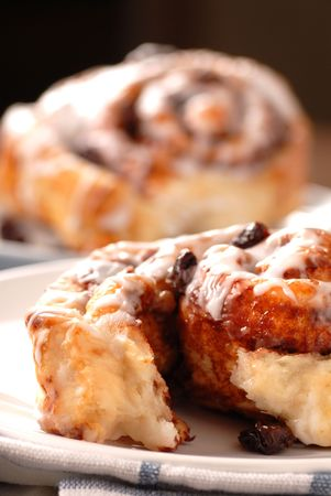 Two freshly baked cinnamon buns served for breakfast