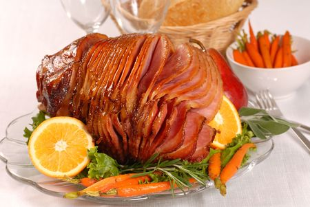 Brown sugar and honey glazed ham with carrots, herbs, fruit and bread