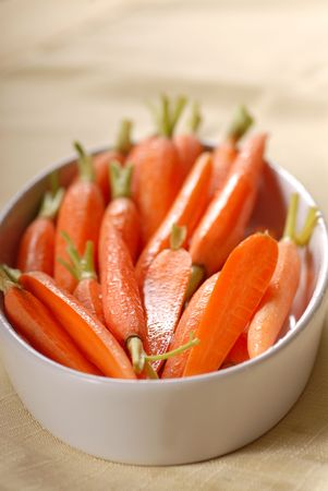 Fresh organic   carrots placed in a serving dish