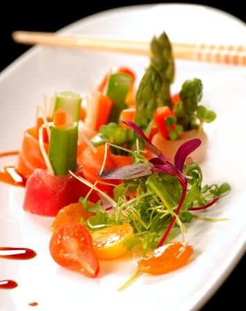 Variety of fresh japanese sashimi on a white plate