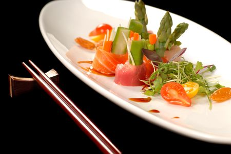 Delicious freshly made japanese sashimi with chop sticks along side Stock Photo
