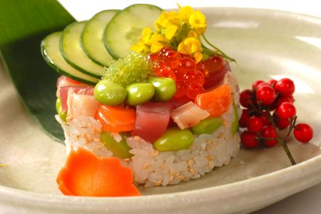 Fresh seafood appetizer of rice with tuna, salmon and vegetables