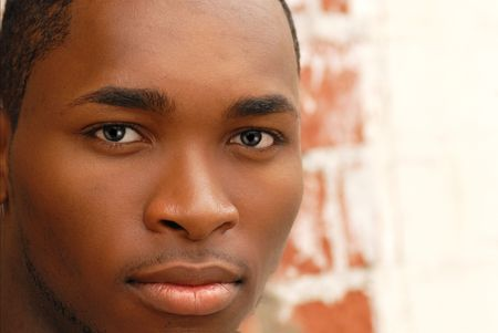 Closeup of the face of an African American male with a faint smile