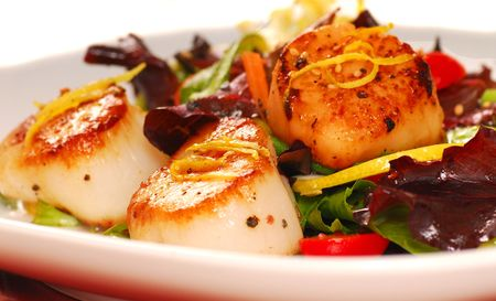 Fresh seared sea scallops with a salad Stock Photo