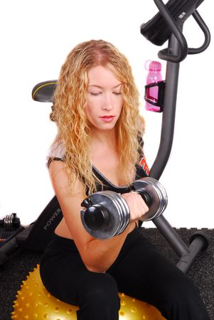 Young attractive physically fit woman works out with a dumb bell Banco de Imagens