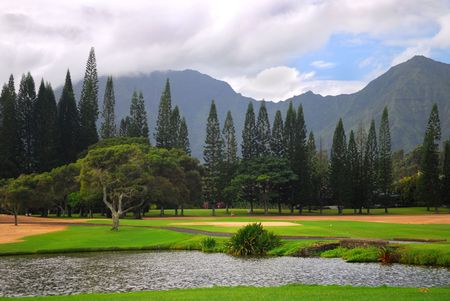 Tranquil setting of a golf course with a mountain background in Kauai, Hawaii