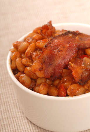 Homemade BBQ pork and beans with strips of bacon Stock Photo