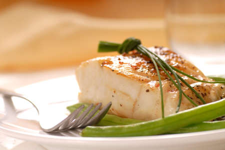 seafood dinner: Fresh sauteed cod fillet with green beans and chives