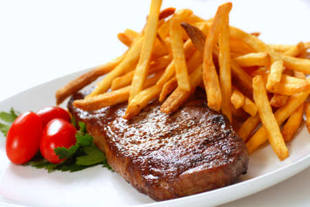 seared: Freshly seared steak with French Fries and tomatoes