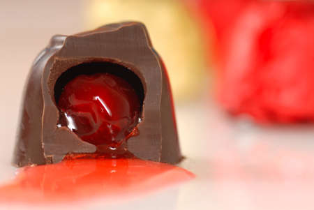 semisweet: Chocolate covered cherry that has been bitten into so its juice flows out