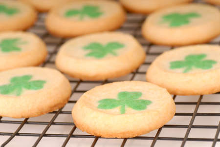 Freshly baked St. Patricks Day sugar cookies cooling on a rack photo