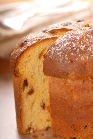 Freshly baked Italian Panettone Christmas bread with a slice cut out