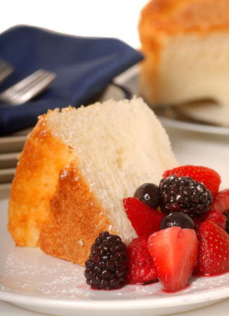 Freshly baked slice of Angel Food Cake with fresh fruit Stock Photo