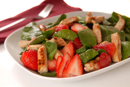 Fresh spinach and strawberry salad with grilled chicken