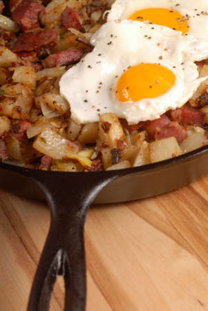 sunnyside: Southern breakfast of corned beef hash with a sunnyside up egg Stock Photo