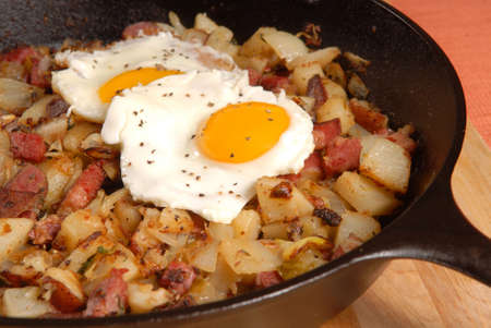 Southern breakfast of corned beef hash and sunny side up eggs