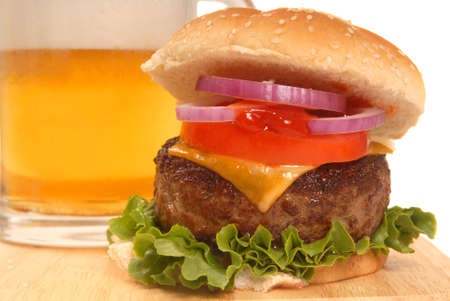 pilsner glass: Freshly grilled cheeseburger with a cold beer Stock Photo