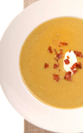 Homemade split pea soup with sour cream and bacon photo