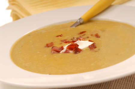 Homemade split pea soup with bacon and sour cream