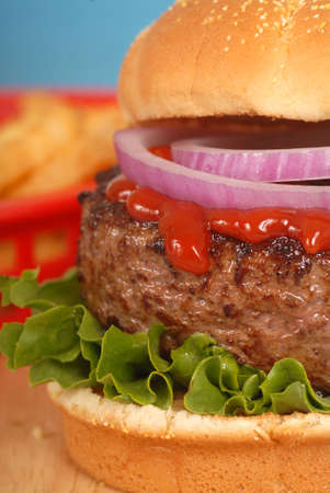 tomato catsup: Freshly grilled hamburger with onions and ketchup