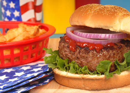 Freshly grilled hamburger in a 4th of July setting