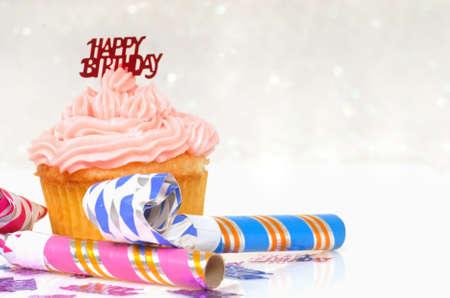 ganache: Freshly baked vanilla cupcake with a birthday theme Stock Photo