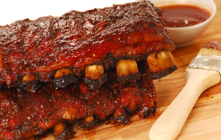 cookout: Two slabs of delicious BBQ spare ribs with dipping sauce Stock Photo