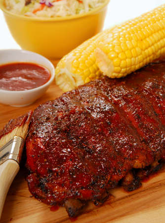 Freshly grilled BBQ spare ribs with cole slaw, corn on the cob and dipping sauce