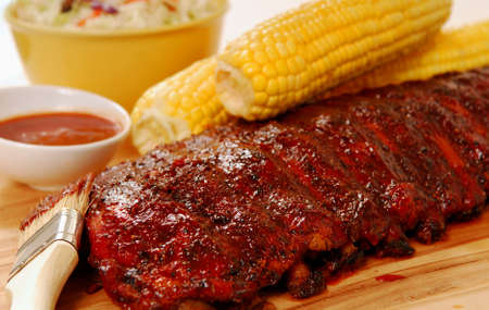 Freshly grilled BBQ Ribs with corn on the cob photo