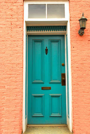 door knob: Old colorful colonial door with lantern found in Frederick, Maryland Stock Photo