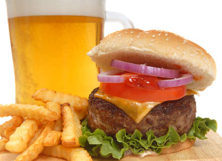 cheeseburger with fries: Freshly grilled cheeseburger with french fries and beer