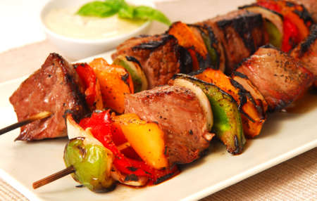 Freshly grilled shish kabobs with a horseradish dipping sauce photo