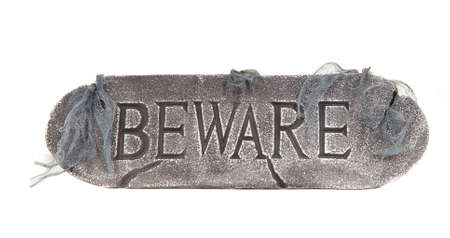 Scary Halloween sign with cobwebs saying Beware Stock Photo - 5370888