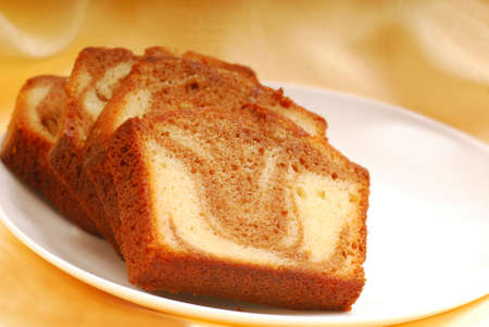 cinnamon swirl: Freshly baked slices of cinnamon swirl pound cake Stock Photo
