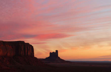 Dramatic sunrise in Monument Valley with the first light striking the rock formations Stock Photo - 5817573