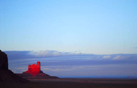 Dramatic sunset in Monument Valley with the fading light striking a monument Stock Photo - 5817674