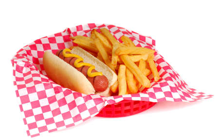 potato fries: Freshly grilled hot dog with mustard and french fries in a serving basket Stock Photo