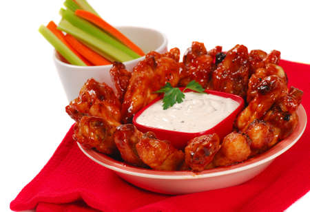 hot wings: Hot and spicy chicken wings with blue cheese dipping sauce along with carrot and celery sticks Stock Photo