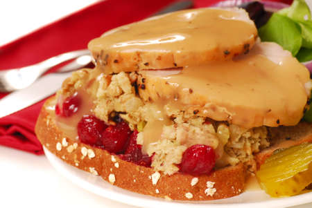 Delicious open faced turkey sandwich with dressing and cranberries
