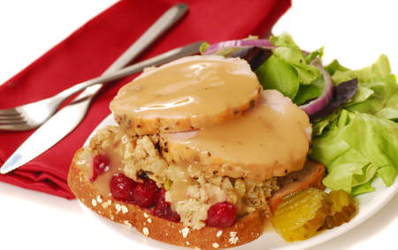 Open faced turkey sandwich with dressing and cranberry sauce Stock Photo
