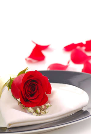 Rose on a dinner plate in a romantic setting Stock Photo - 6367334
