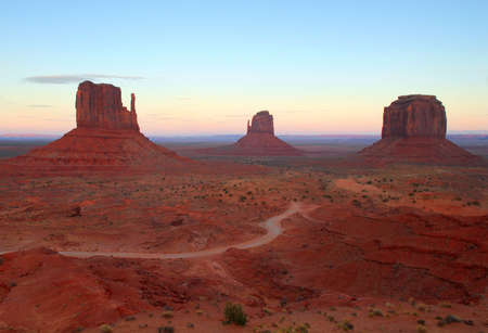 tribal park: Dramatic view of the MIttens in Monument Valley at sunrise Stock Photo