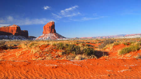 Colorful rock formations with a dusting of snow in the Navajo Nation Park Monument Valley Stock Photo - 6689101