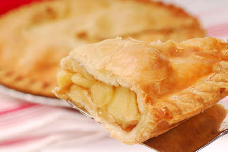 Delicious slice of freshly baked apple pie on a spatula photo