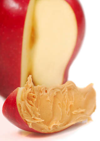 peanut butter: Delicious red apple slice with peanut butter spread on it