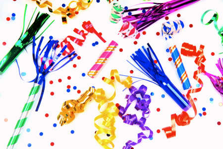 Multi-colored party favors shown on a white surface Standard-Bild