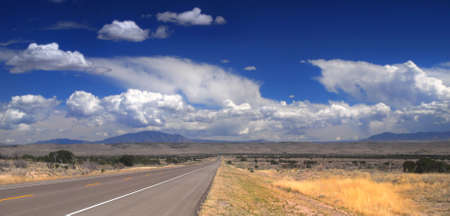 desolate: Desolate stretch of road in rural New Mexico with dramatic sky Stock Photo