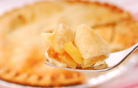 Bite of freshly baked apple pie on a fork Stock Photo