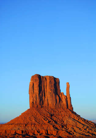 large formation: Sunset view of the Mitten in Monument Valley