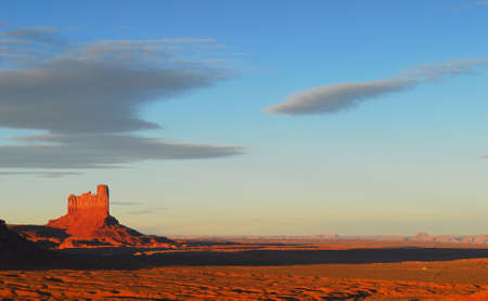 Sunset in Monument Valley creating a dramatic light striking the rock formations Stock Photo - 7022636
